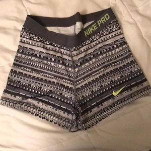 gray and green nike pros